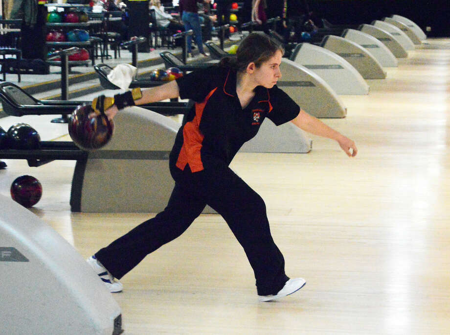 Edwardsville freshman Rachel McTague eyes the pins during the third game against the Alton Redbirds at Bowl Haven Lanes in Alton.
