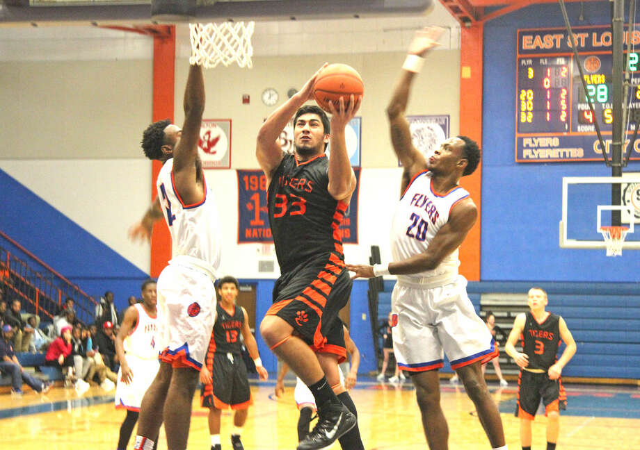 Edwardsville junior A.J. Epenesa drives to the basket during Tuesday's Southwestern Conference game at East St. Louis.