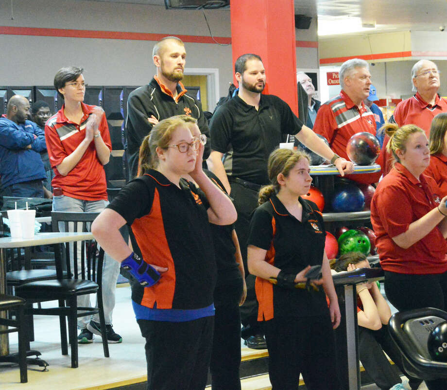 The Edwardsville girls' bowling team watches during a Southwestern Conference match against Alton at Bowl Haven Lanes on Monday.