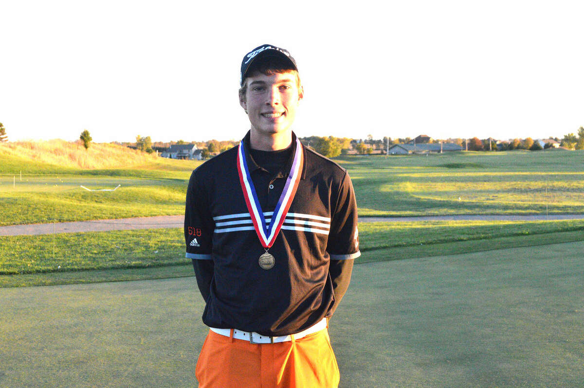 Edwardsville senior Justin Hemings poses with his state championship medal after winning the Class 3A state tournament in Bloomington.
