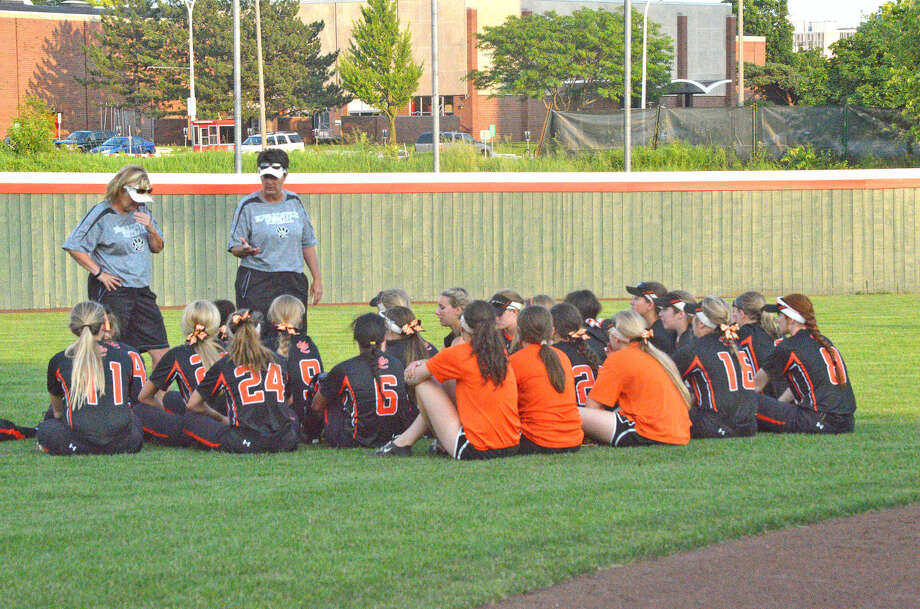 Edwardsville softball coach Lori Blade talks to her team after the Tigers' season ended with a 14-1 loss to Lincoln Way-East in Monday's Class 4A super-sectional in Normal. EHS, which entered the game ranked sixth in the state, finished with a 29-5 record.