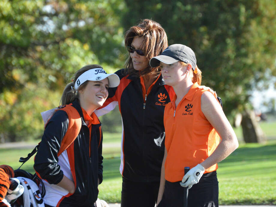 Edwardsville girls' golf coach Tresa LaBoube, center, talks to sophomore Paige Hamel, left, and senior Sam Doak on the 17th tee box at Weibring Golf Club in Normal during the Class AA Normal Community Sectional on Oct. 12.