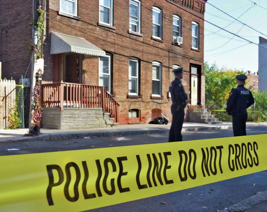 "Police stand guard outside 1 East Glen Avenue as they investigate a man's ""suspicious death"" Tuesday Oct. 18, 2016 in Troy, NY.  (John Carl D'Annibale / Times Union) Photo: John Carl D'Annibale / 20038444A"