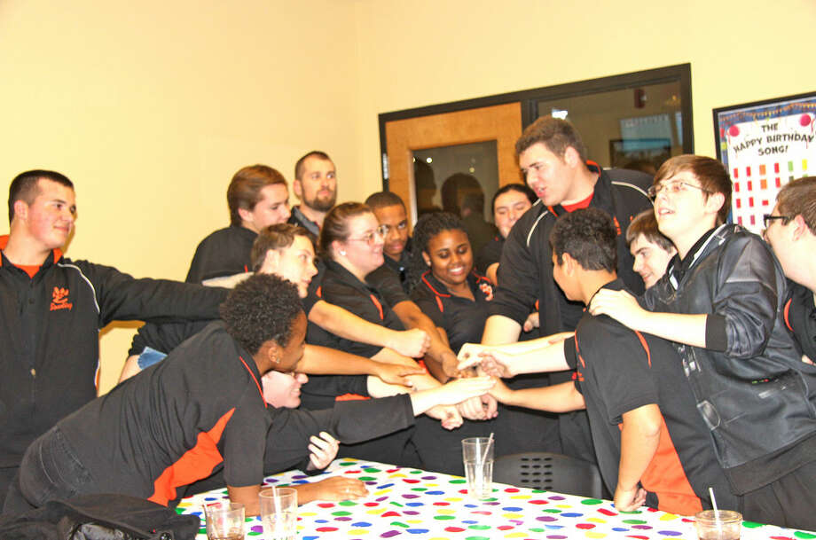The Edwardsville boys' and girls' bowling teams wrap up their meeting after Thursday's losses to Belleville East at Edison's.
