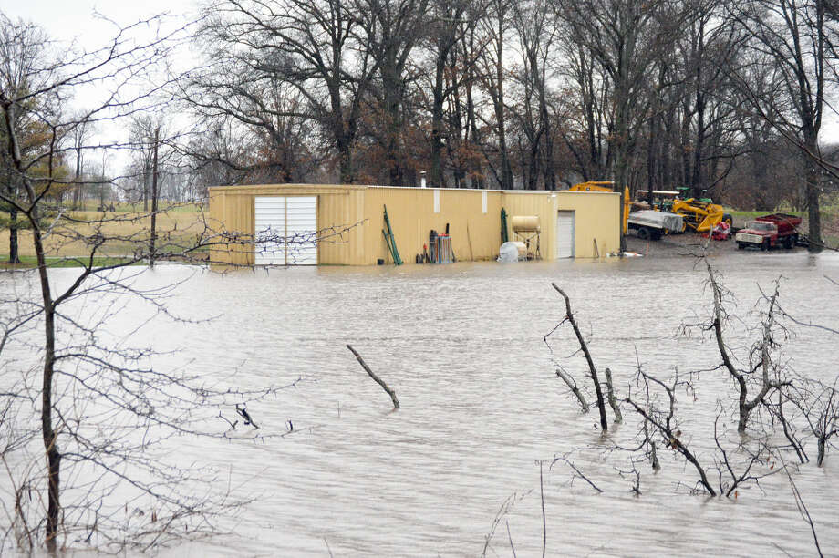The Oak Brook Golf Club maintenance shed, seen here from Fruit Road, sits under water on Dec. 28 after three days of rain.