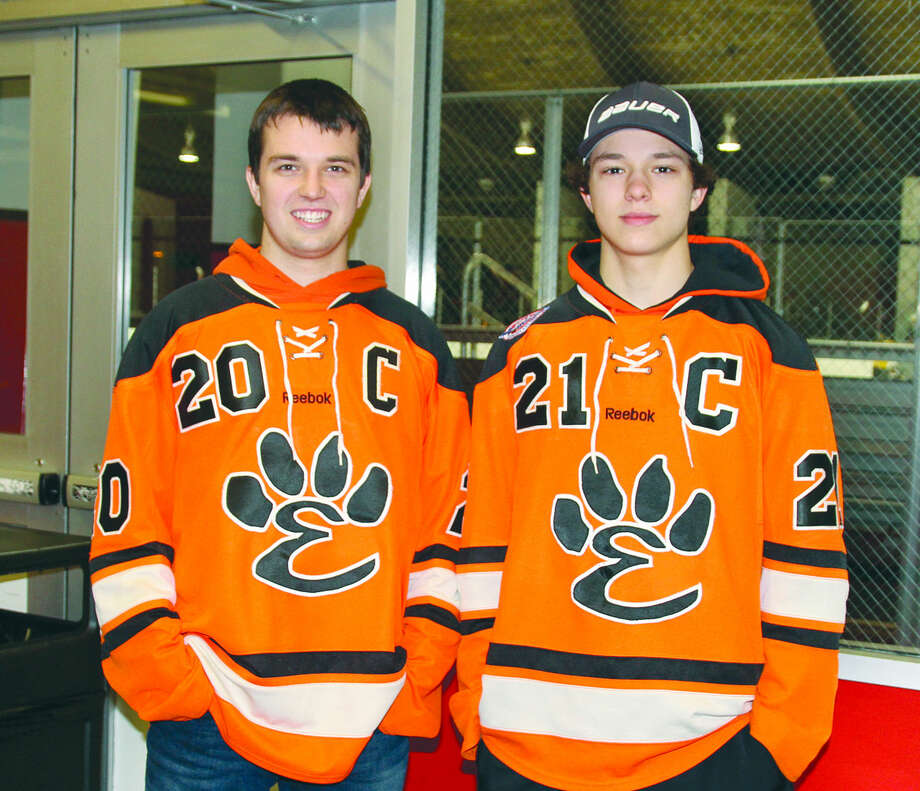 Drew, left, and Carson Lewis pose for a photo at the Granite City Ice Rink. Carson is currently captain of the EHS ice hockey team, a position Drew held two years ago as a senior. Photo: Rachel Lewis/For The Intelligencer