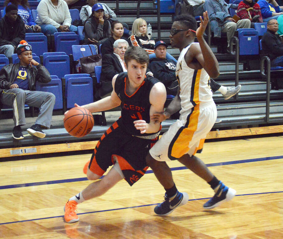 Edwardsville guard Oliver Stephen looks to blow past the O'Fallon defender near the baseline during second-quarter action Friday in O'Fallon. The Tigers stayed undefeated in the Southwestern Conference with a road win.
