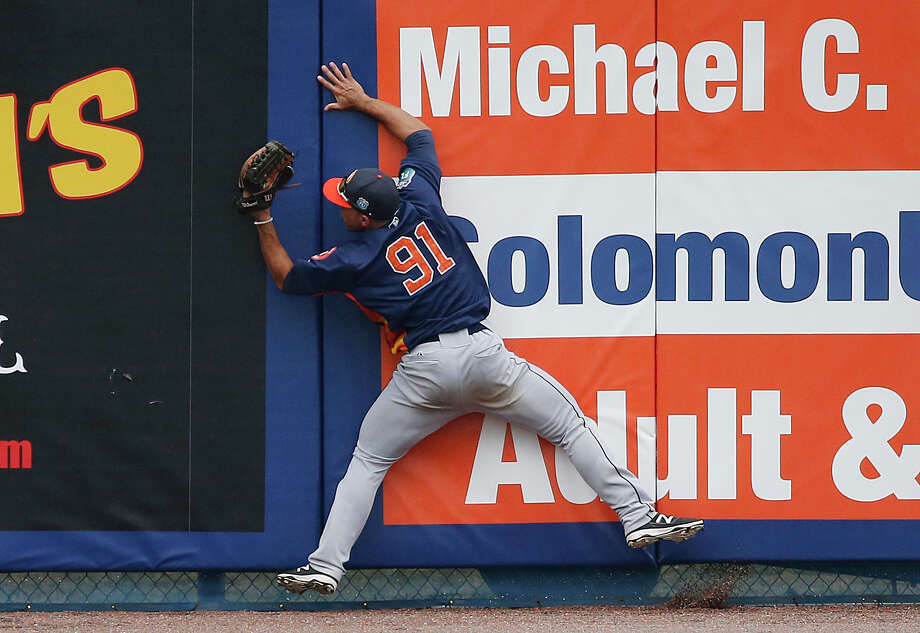 Houston Astros' center fielder Ramon Laureano, stumbles into the wall after catching a fly ball hit by New York Mets' David Wright during the sixth inning of an exhibition spring training baseball game, Thursday, March 24, 2016, in Port St. Lucie, Fla. (AP Photo/Brynn Anderson) Photo: Brynn Anderson/AP
