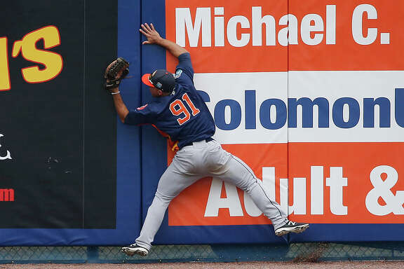 Houston Astros' center fielder Ramon Laureano, stumbles into the wall after catching a fly ball hit by New York Mets' David Wright during the sixth inning of an exhibition spring training baseball game, Thursday, March 24, 2016, in Port St. Lucie, Fla. (AP Photo/Brynn Anderson)