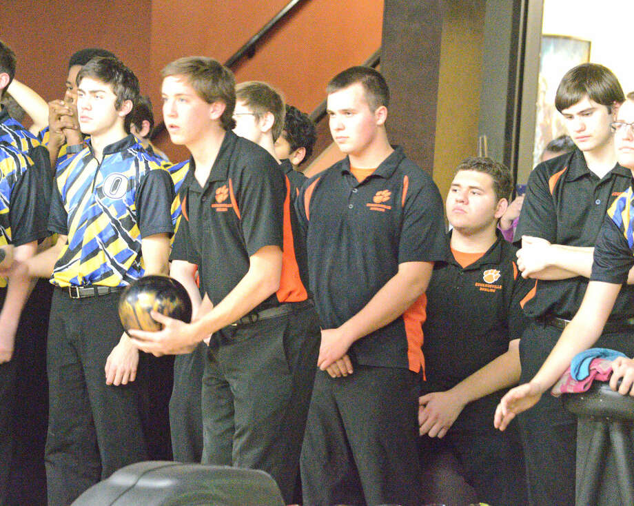 Edwardsville's Tommy Hartnagel gets ready to bowl during Wednesday's Senior Night match against O'Fallon at Edison's, as fellow seniors, left to right, Tyler Cooper, Mitch McSparin and Matt Brust look on.