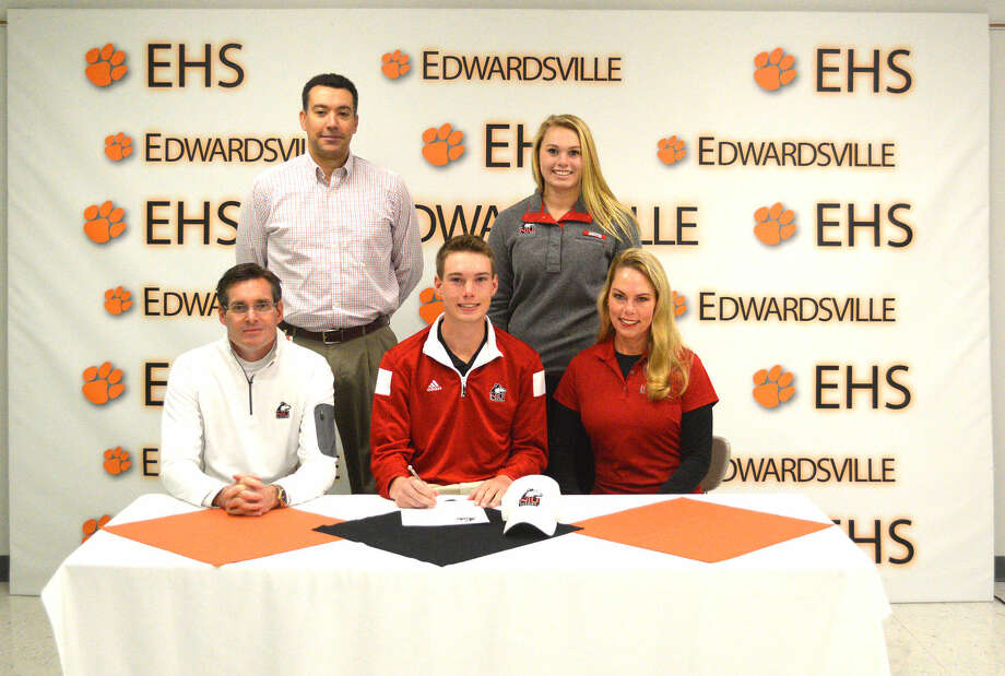 Edwardsville senior Justin Hemings signed a scholarship to play golf at Northern Illinois University. Front row, left to right, father Paul Hemings, Justin Hemings and mother Lisa Hemings. In the back, left to right, are EHS golf coach Dene Schickedanz and sister Lydia Hemings.