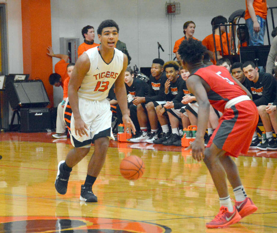Edwardsville guard Mark Smith shouts out instruction while bringing the ball across halfcourt.