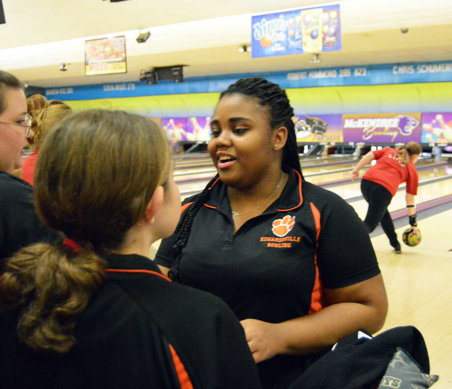 Edwardsville's Jhalyn Mcmath is congratulated by teammates after finishing the third of six games at the Panther Challenge at St. Clair Bowl in Fairview Heights on Saturday.