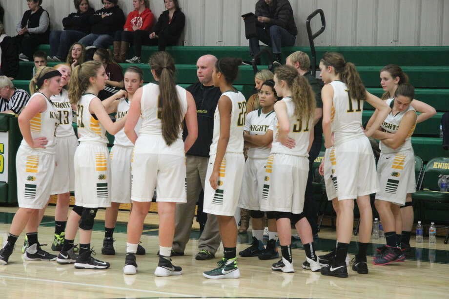 Metro-East Lutheran coach Rob Stock talks to his team during a timeout in the Dec. 7 game against Nokomis.