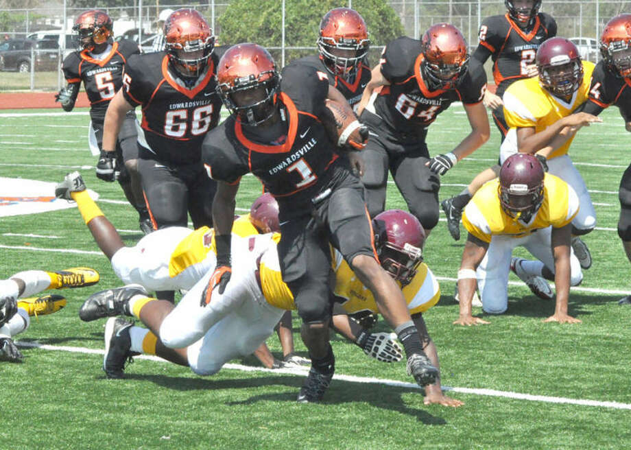 Edwardsville's Craig James breaks away from a Soldan defender during his senior season with the Tigers. James led the signing class for EHS on Wednesday, announcing he would continue his football career at the University of Minnesota.