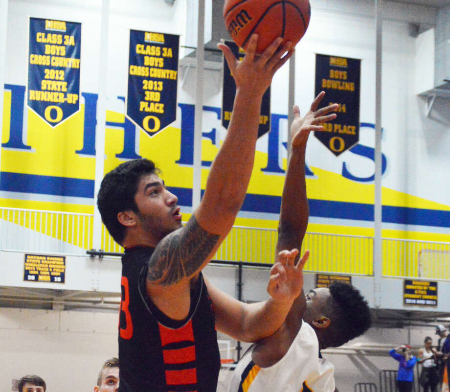 AJ Epenesa goes up for a layup over an O'Fallon defender during first-quarter action.