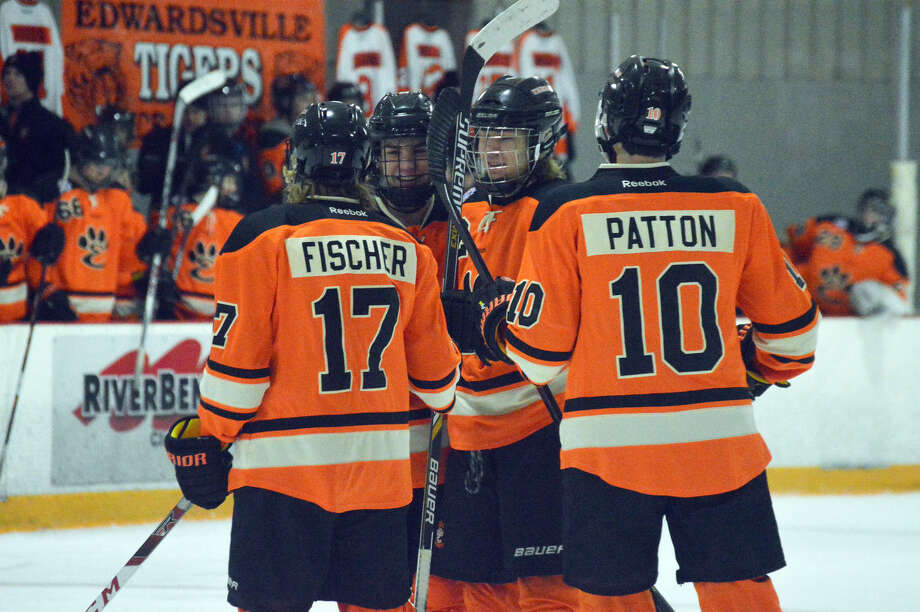 Members of the Edwardsville ice hockey team celebrate after scoring a goal against Civic Memorial on Monday at the East Alton Ice Arena.