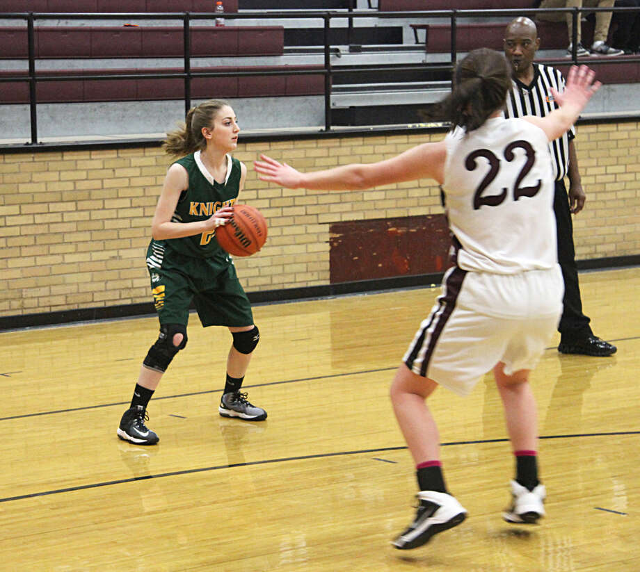 MELHS guard Audrey Paitz catches the ball in the corner during the second half of Monday's win at Dupo.