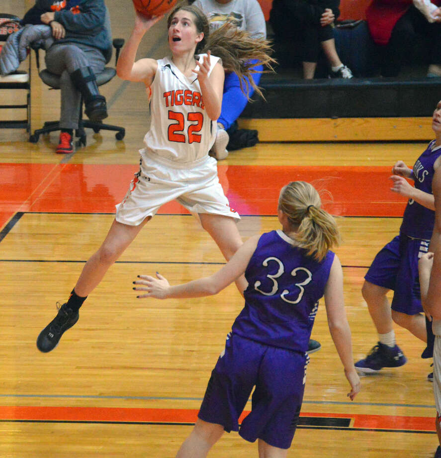 Edwardsville sophomore Kate Martin goes up for a layup in the third quarter with Collinsville's Carlee Mahan looking on Monday at Lucco-Jackson Gymnasium.