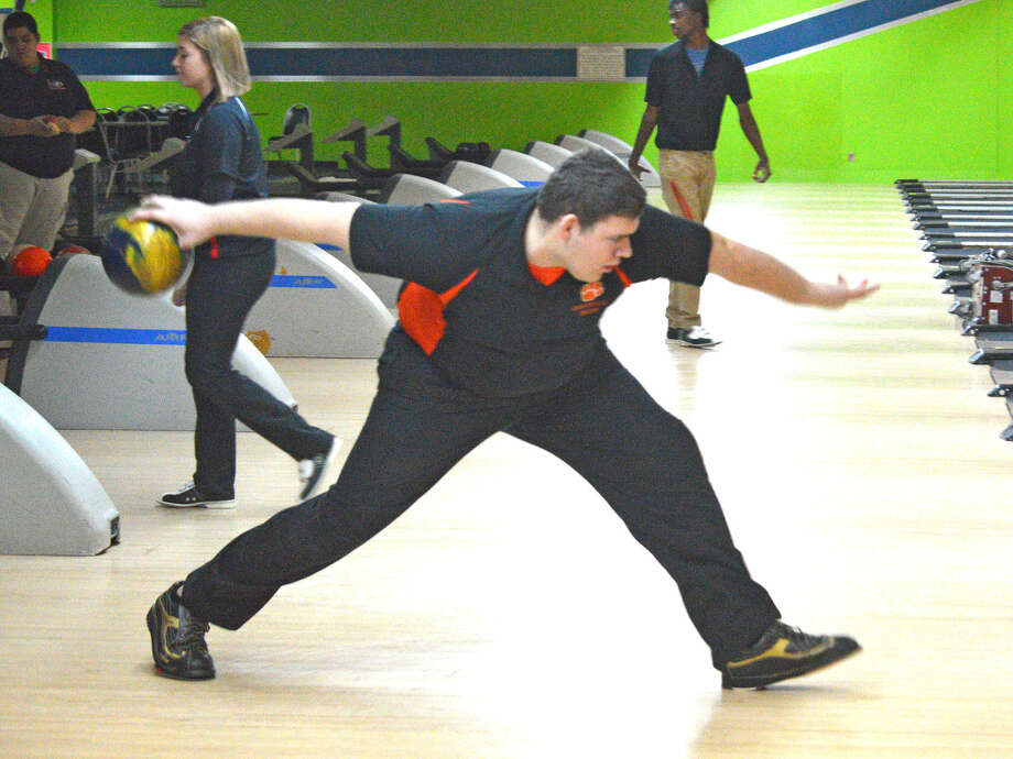 Edwardsville senior Mitch McSparin bowls during Tuesday's dual match against Granite City at Airport Bowl in Bethalto.