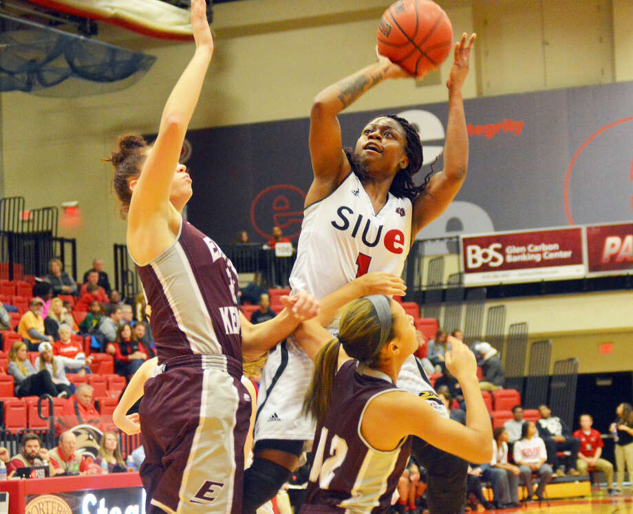 SIUE guard CoCo Moore goes up for a shot over two EKU defenders in first-half action Saturday at the Vadalabene Center.