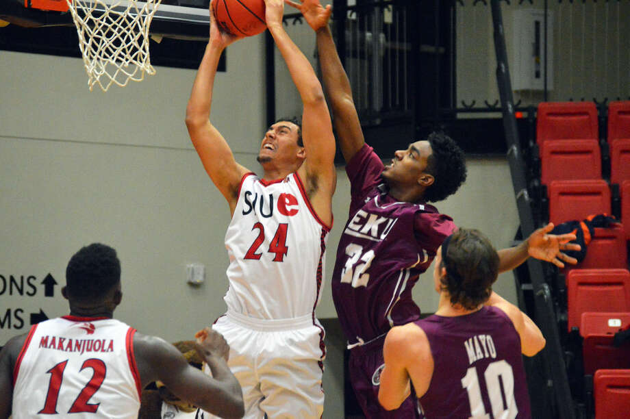 SIUE forward Jalen Henry (No. 24) goes up for a dunk with Eastern Kentucky's Ja'Mill Powell trying to defend midway through the first half at the Vadalabene Center on Saturday.