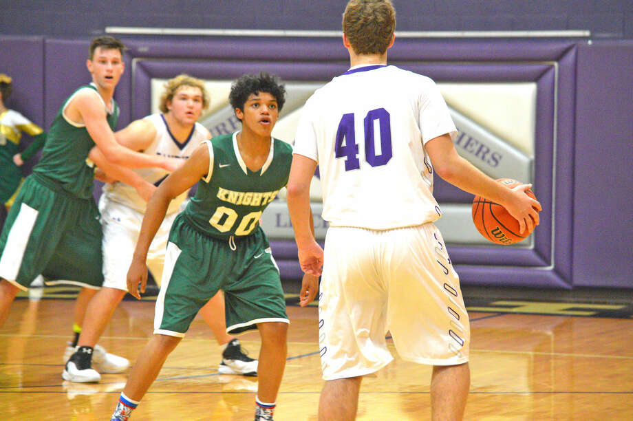 Metro-East Lutheran senior Teddy Fifer guards Litchfield's Cooper Scharf during Saturday's first-round game at the Litchfield Invitational.