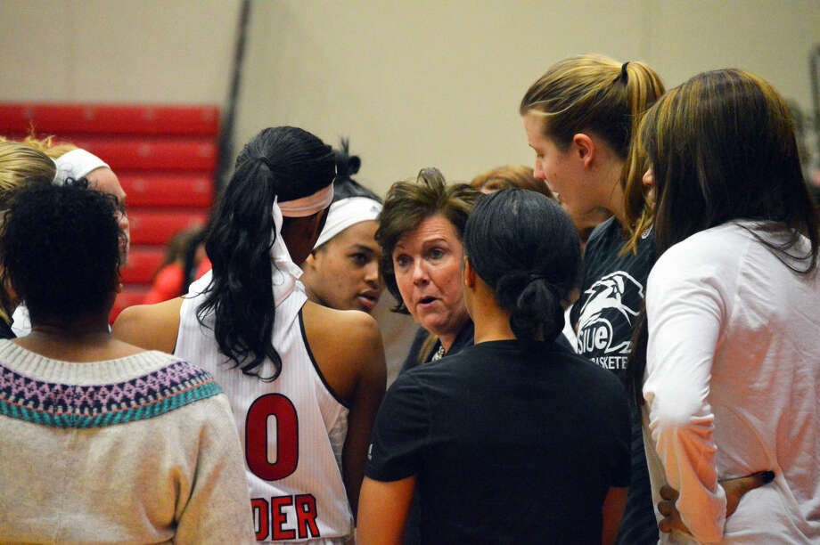 SIUE coach Paula Buscher talks to her team before the start of the second half Wednesday against SEMO at the Vadalabene Center.