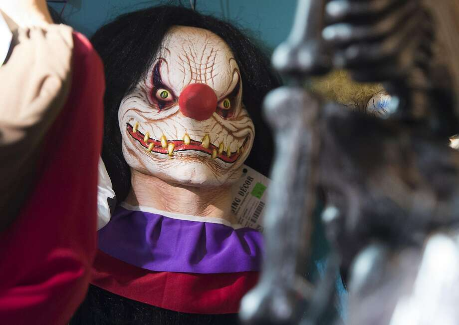 "FILE-- Halloween costumes and props, including a ""scary"" clown mask, are seen for sale at Total Party, a party store, in Arlington, Virginia, October 7, 2016. Kemper County, Mississippi has passed an ordinance making it illegal for people to wear clown makeup, costumes and masks. Photo: SAUL LOEB, AFP/Getty Images"