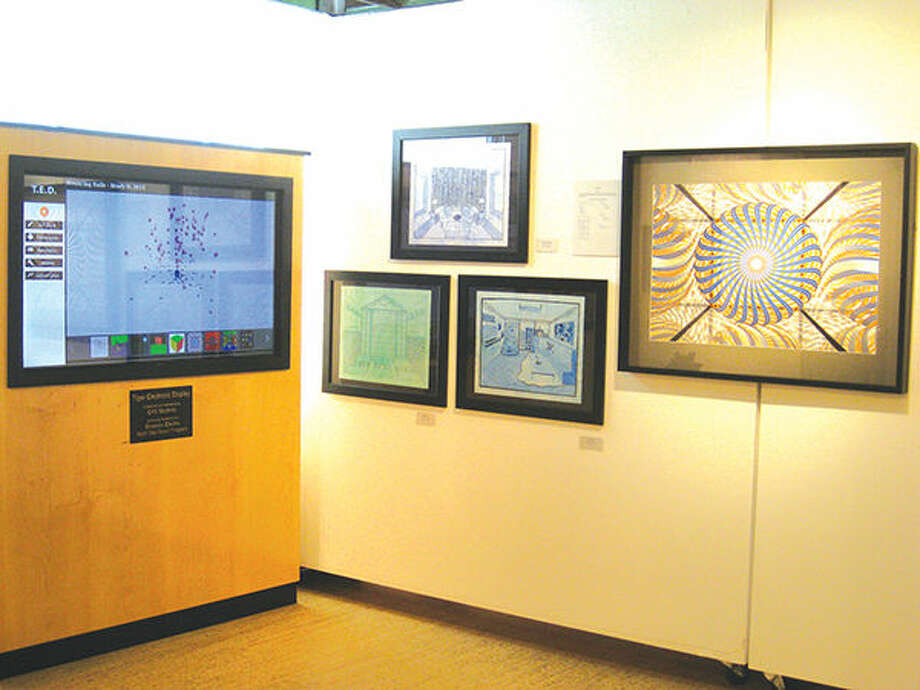 Pictured are some of the works of art created using math by Edwardsville High School students. The works are currently on display in the Edwardsville Arts Center's Dennis DeToye Student Gallery. Photo: Julia Biggs/Intelligencer