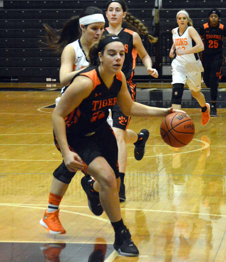 Edwardsville's Rachel Pranger drives to the basket after stealing the ball against Carterville on Friday in Carbondale.