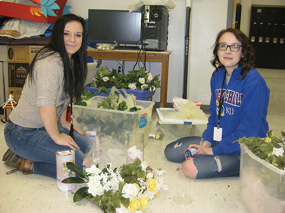 EHS HOSA Historian Emma Donelson (left) and HOSA Fundraising Chair Ashley Defend (right) prepare centerpieces for their HOSA Tea Party event this Sunday. Photo: Julia Biggs/Intelligencer