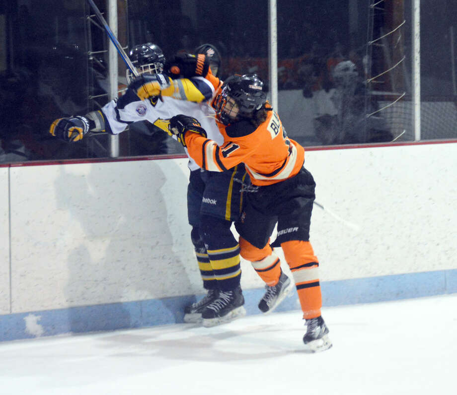 Edwardsville senior Chris Blandina finishes off a check in the second period.