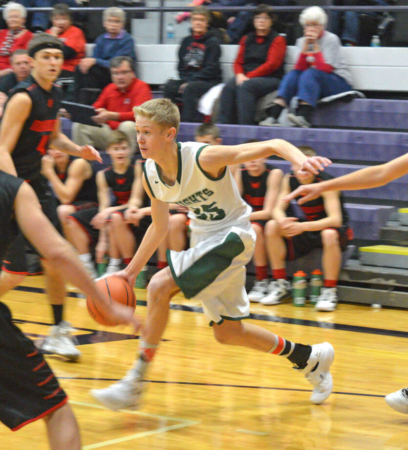 Metro-East Lutheran guard Noah Coddington drives toward the basket during first-half action against Nokomis in Litchfield on Tuesday.
