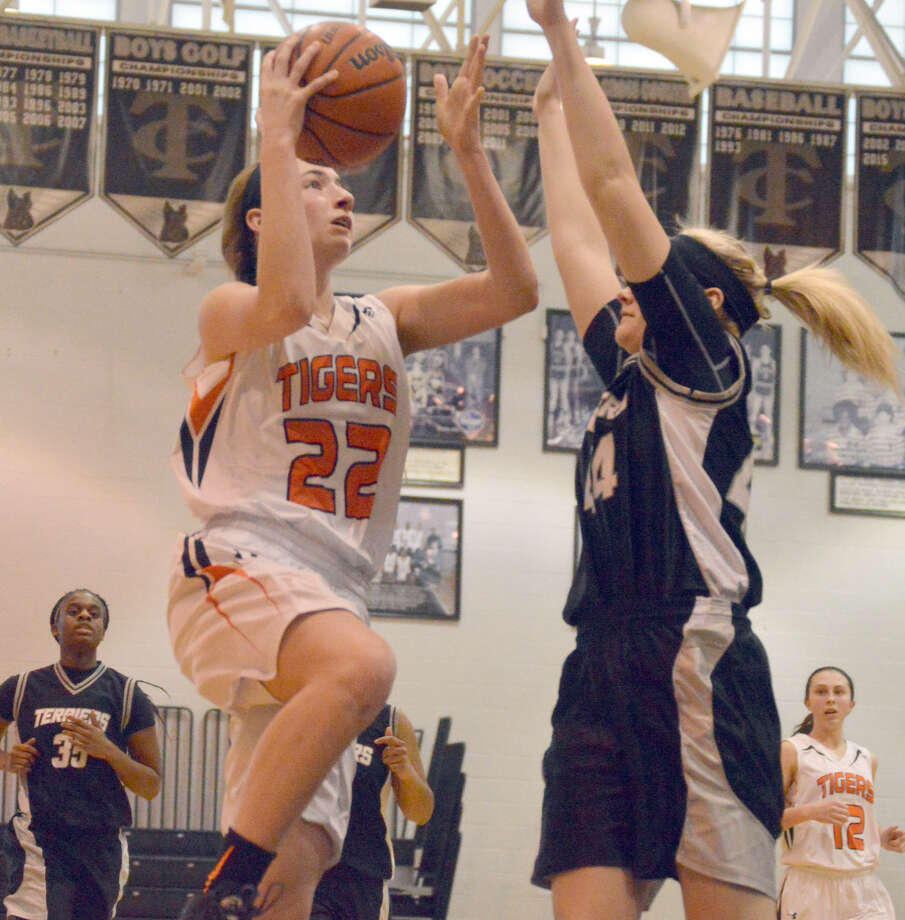 Edwardsville guard Kate Martin goes up for a layup after a steal against Carbondale in the third quarter.