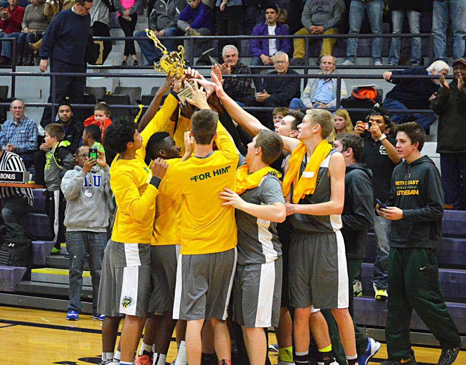 MELHS boys' basketball celebrates after winning the Litchefield tournament.