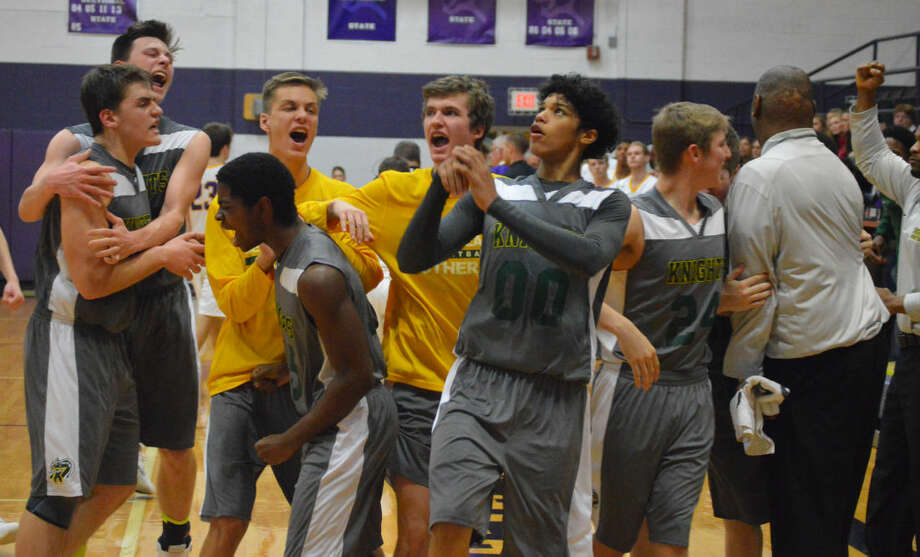 The Metro-East Lutheran basketball team begins to celebrate after winning the 49th annual Litchfield Invitational.