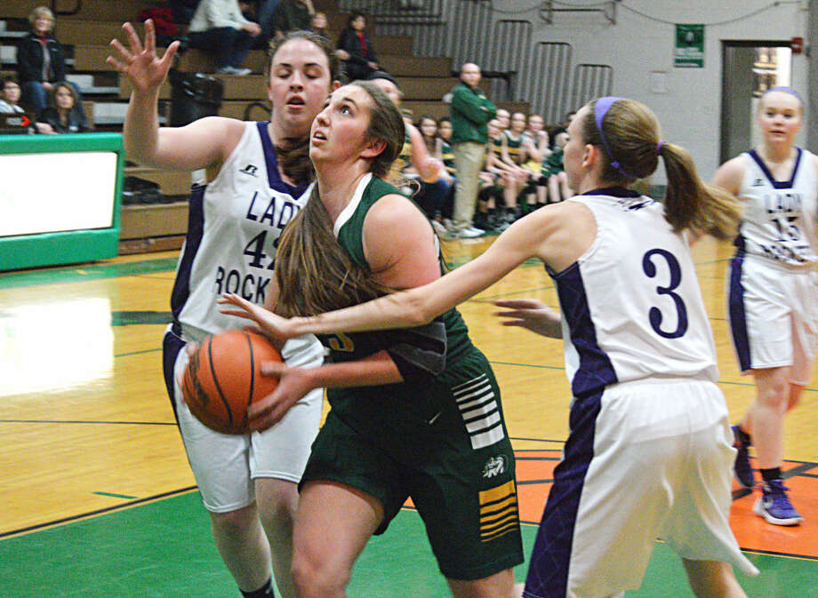 Metro-East Lutheran senior Karly Schley gets fouled as she goes up for a layup in the first quarter of the Knights' game against Jacksonville Routt.
