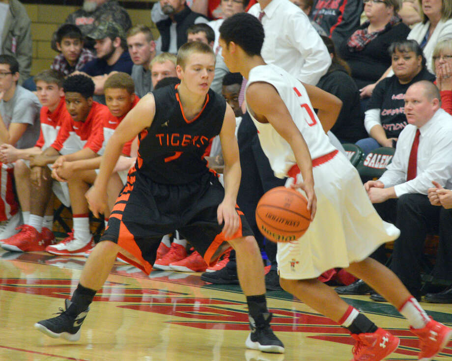 Edwardsville sophomore guard Sammy Green, left, defends Centralia's D'Aaron Owens in the championship game of the Salem Invitational on Saturday.