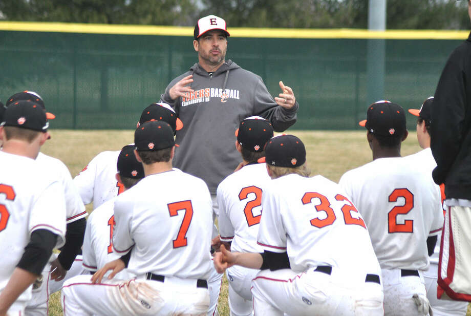 Tigers coach Tim Funkhouser talks to his players after the game.