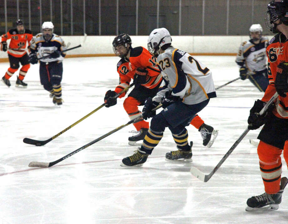 Edwardsville's Stanley Lucas tries to get past Columbia's Jake Baskett during Tuesday's game at the East Alton Ice Arena.