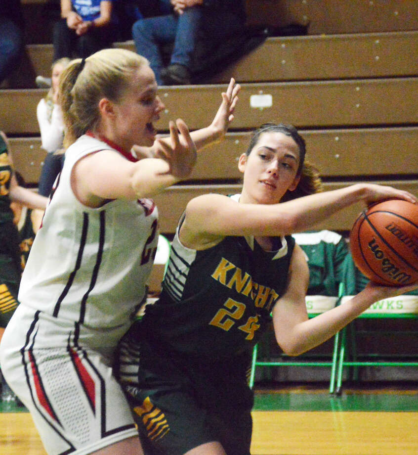 Metro-East Lutheran's Emma Eberhart tries to pass the ball to a teammate after getting stopped on the baseline against Granite City in Carrollton on Wednesday.