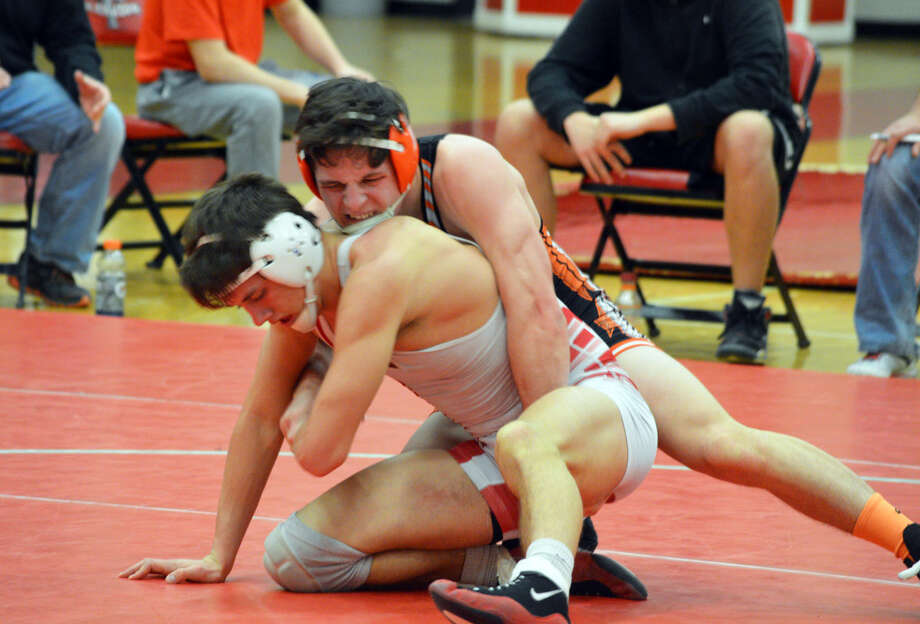 Edwardsville's Mason Taylor tries to keep his Chatham Glenwood opponent down in the second round of his match at 160.