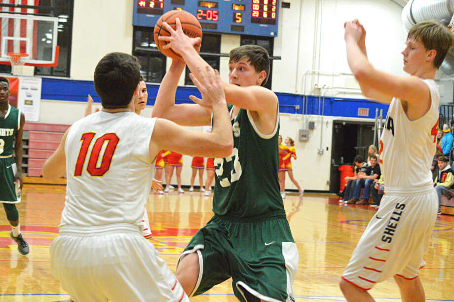 Metro-East Lutheran's Braden Woolsey grabs a rebound and looks for an open teammate during the fourth quarter in Roxana.