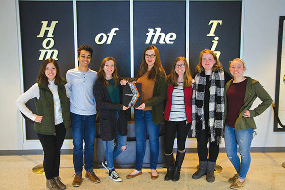 Current EHS yearbook staff members are, from left: Miranda Lintzenich, CJ Carpenter, Katy DeConcini, Hannah Wente, Maddi George, Jessie Thorpe and Devin Kane. Three of the editors who have graduated are: co-editors-in-chief Emily Ash and Sam Jueckstock and chief photographer Shawn Semmler. Also not pictured is current senior Katie McGarr. Photo: For The Intelligencer