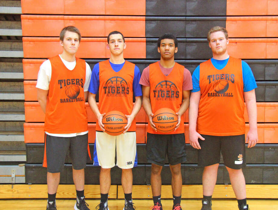 Scout team players for Edwardsville boys' basketball include, from left, seniors Ryan Pacatte, Kent Roberts and Jalyn Williams and junior Sam Bledsoe.