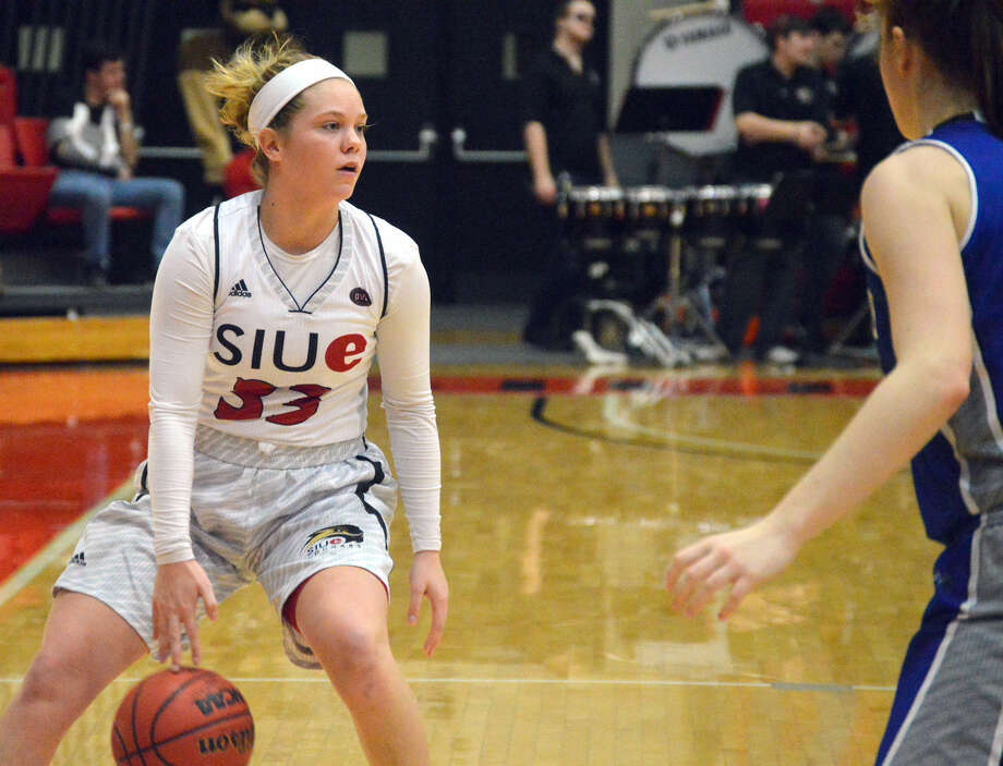 SIUE guard Sidney Smith, left, runs the offense during fourth-quarter action against Eastern Illinois at the Vadalabene Center on Saturday.