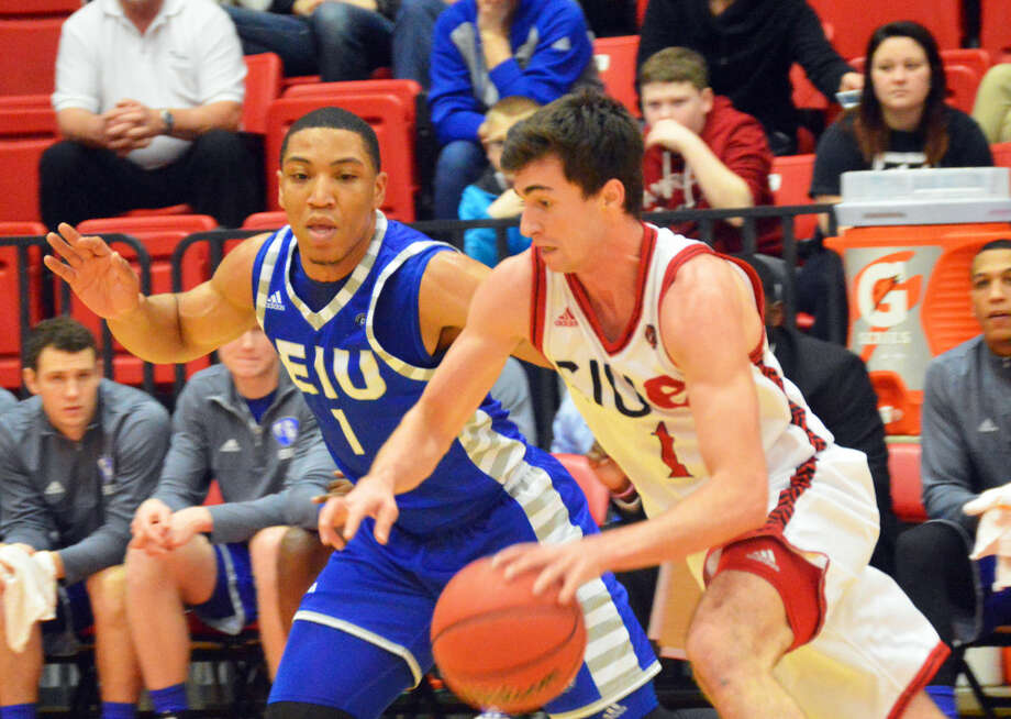 SIUE guard Burak Eslik, right, tries to drive past an Eastern Illinois defender during first-half action at the Vadalabene Center on Saturday.