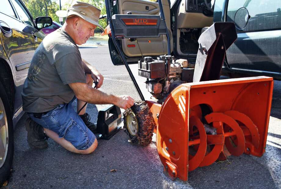 Brian Robert takes advantage of today's warm weather to tune up his snow blower Tuesday Oct. 18, 2016 in Waterford, NY.  (John Carl D'Annibale / Times Union) Photo: John Carl D'Annibale / 20038445A