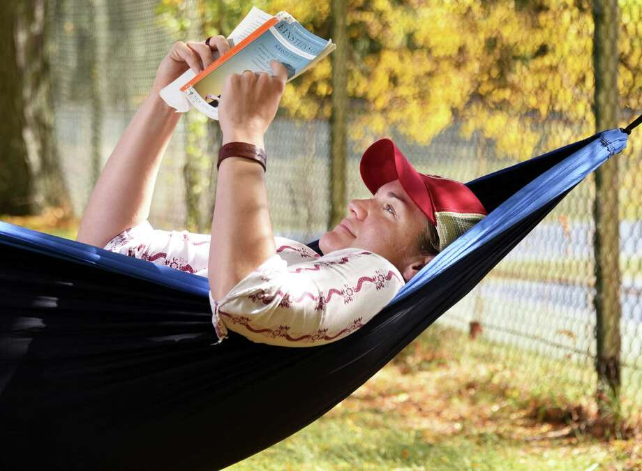 Margaret Decker of Kingston gets in some hammock time between Sage College nursing classes at Prospect Park Tuesday Oct. 18, 2016 in Troy, NY.  (John Carl D'Annibale / Times Union) Photo: John Carl D'Annibale / 20038445A